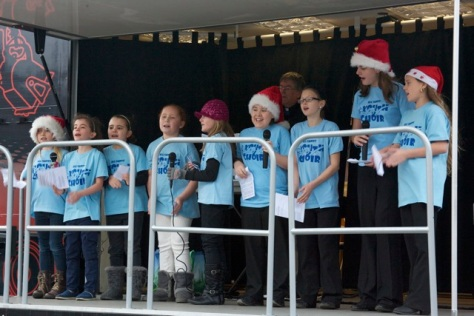 All Saints Youth Choir, accompanied by Revd Roger Williams, were in fine festive song on the Move truck