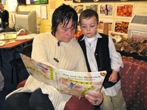 Barabara Lowndes helps grandson Kaiden Ali, aged 4-5, with his reading