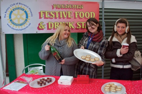 Carrie Hurst (left), Jennie Allport and Jess Woolley serve up sherry and mince pies on behalf of Rotary