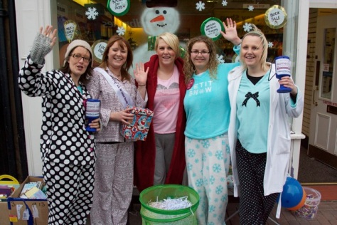 Not snoozing - but amusing! Pyjama-clad Co-op Travel staff collect for Women's Aid