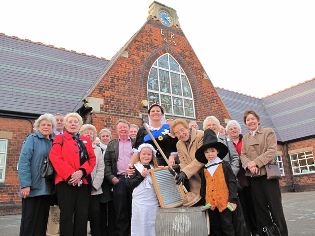 Queen Victoria is amused as she joins guests and pupils under the gaze of the 1828 school clock