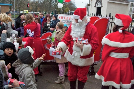 Santa and his posse hand out the goodies!
