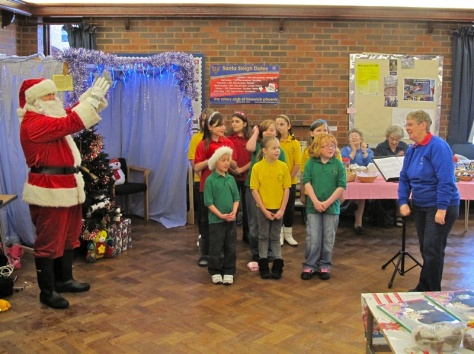 Santa leads the youngsters of St John's Methodist Church in song at their 2010 fayre.
