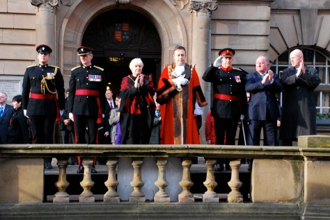 On the reviewing stand the Mayor and Mayoress join the Chief Exec, Leader of the Council and others