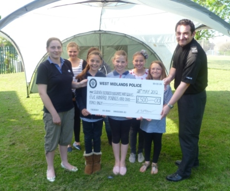 7th Bloxwich Brownies and Guides receive their cheque.