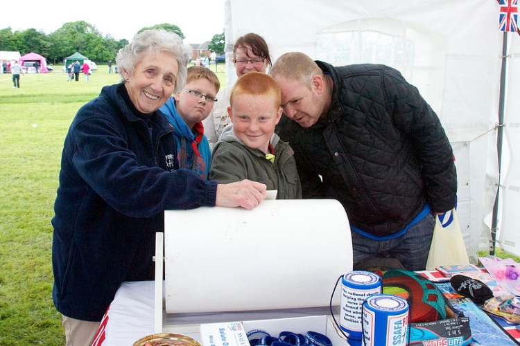 A family has a go at the SSAFA Forces Help Tombola