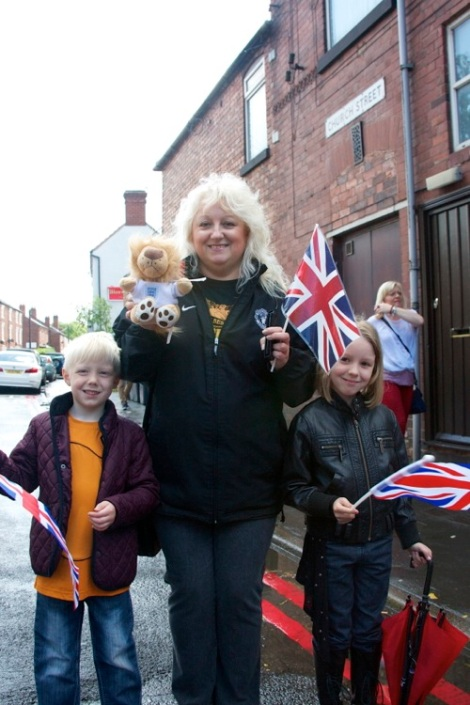 Annette Hunt (centre) and Bradly and Faith Bough show off Lionel the Lion who is raising funds for New Cross Hospital, in Church St, famed for the legendary escaped Bloxwich Lion