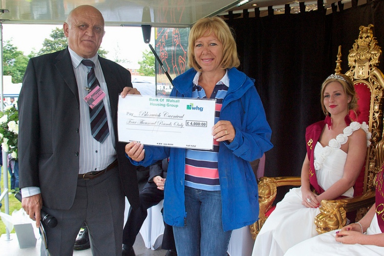 Linda Lister (centre), Estates Service Manager of Walsall Housing Group, presents Bloxwich Carnival Committee Chairman Terry Bate with a cheque for £4000
