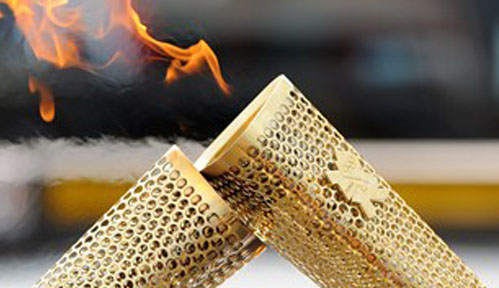 Olympic Torch Kiss (Courtesy London2012.com)