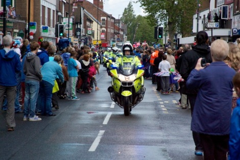 Police outriders escorting the Olympic Torch Relay herald the convoy's approach