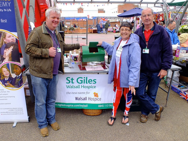 Cllr Shaun Fitzpatrick, Cllr Kath Phillips and Maurice Phillips staffed St Giles Walsall Hospice tombola stall on Bloxwich Market
