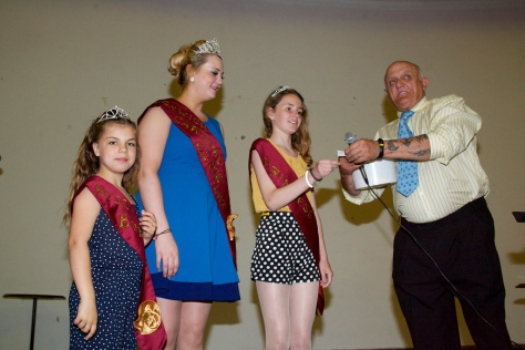 Bloxwich Carnival Royalty (L to R) Megan Leigh Small (Rosebud 2012), Alice Jones (Queen 2012) and Amelia Ellis (Princess 2012) joined forces with Master of Ceremonies Terry Bate (Chairman of Bloxwich Carnival Committee) by drawing raffles