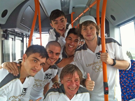 Chris Bridgman on board the Torch Relay Bus with boy band 'The Wanted' (courtesy Chris Bridgman)