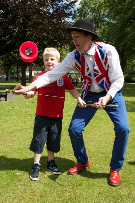 Juggling Jim teaches his circus skills to a young apprentice