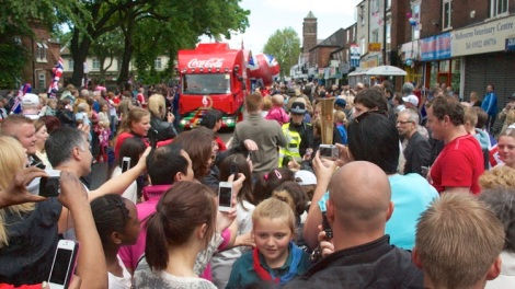 Thierry Laurent from the USA is surrounded as he steps off the bus onto Bloxwich High Street.
