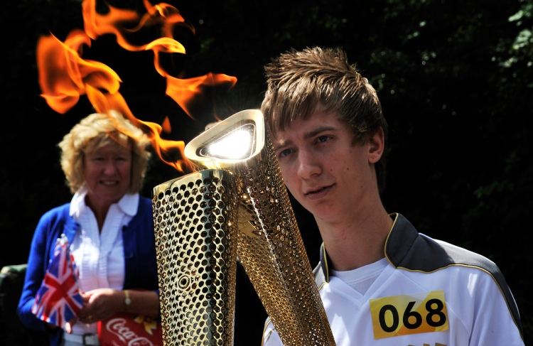 The first Bloxwich Torchbearer, Kris Richardson of Walsall, receives the flame on Stafford Rd (courtesy Gary S. Crutchley)
