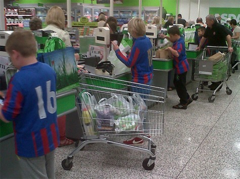 Bloxwich's future football heroes help Asda customers.
