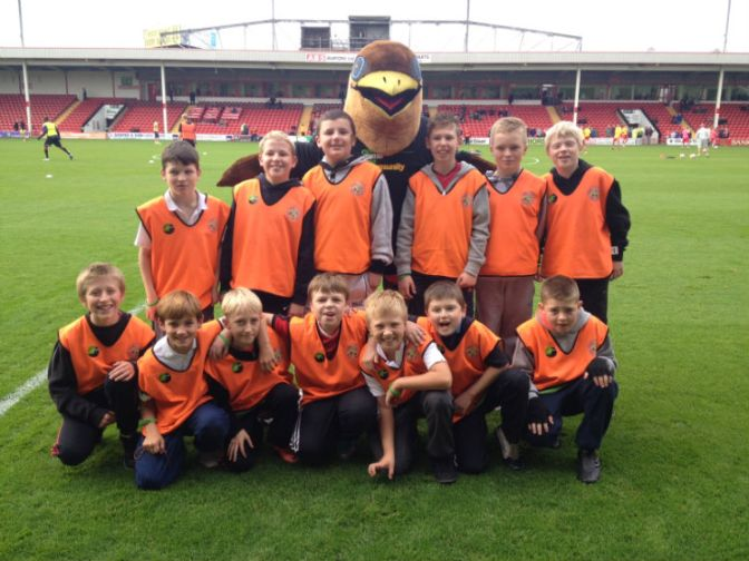 Leamore Primary School students meet Walsall FC mascot Swifty.