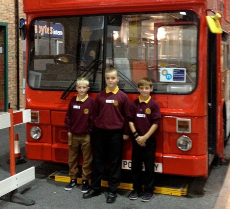 Owen Smith, Alex Snee and Jamie Hendy by the Safeside bus.