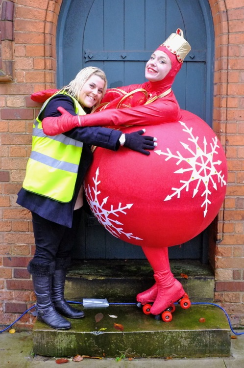 A moment of festive fun as organiser Nikki Rolls gets a hug from a roller-skating Christmas bauble!