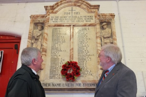 Historians and authors Barry Crutchley (left) and Ken Wayman ponder the men on the memorial.