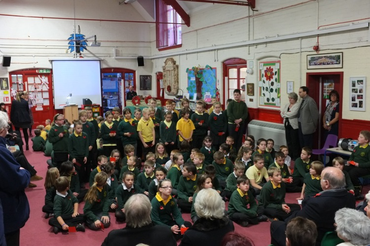 Pupils read the Elmore Green Roll of Honour at a Remembrance service on 11 November this year