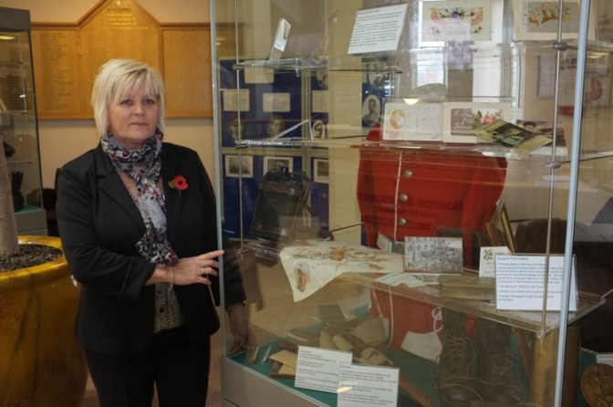 Terri Wall, Service Manager of Blakenall Village Centre, examines artefacts from Walsall Museum in the new exhibition.
