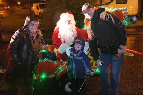 A happy family welcomes Santa to Bamford Rd
