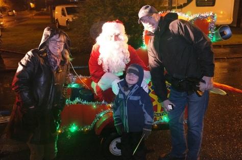 A happy family welcomes Santa to Bamford Rd