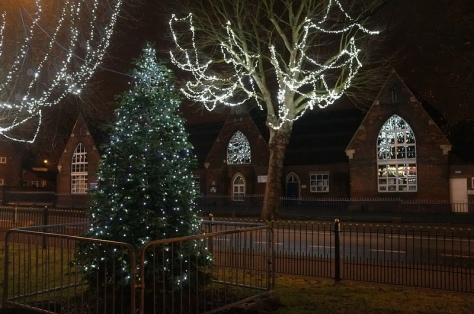 Bloxwich Christmas tree and lights, Promenade Gardens, reflected in the National School