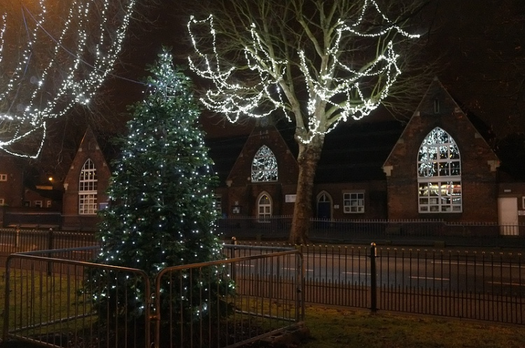 Bloxwich Christmas tree and lights, Promenade Gardens, reflecting in the historic 'National' school windows