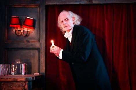 Mr Scrooge reads A Christmas Carol (courtesy Pamela Raith Photography)