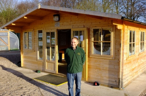 Paul Mason outside the Community Cabin in glorious sunshine