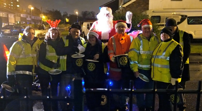 Santa and his little helpers pause in Bamford Rd