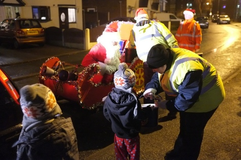 Youngsters brave the cold to make a donation in Belper Rd