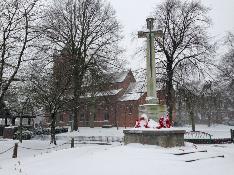 Bloxwich War Memorial and All Saints Church in the snow