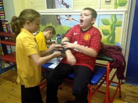 Elishia Firth and Levi Cox taking blood pressures