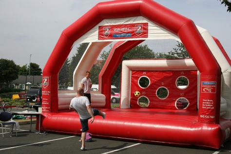 Daddy puts the boot in at the Walsall FC inflatable