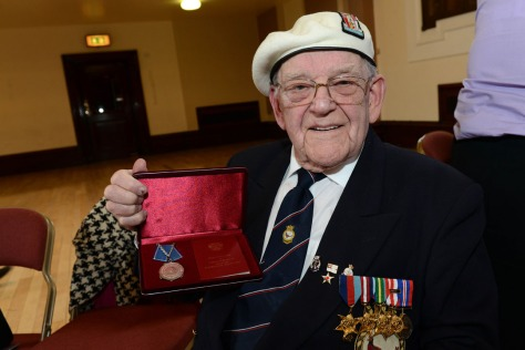 A proud veteran shows off his Ushakov Medal (pic courtesy Ed Bagnall)