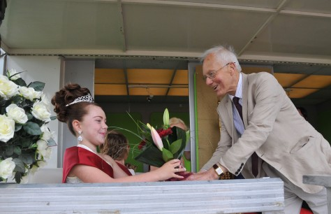 2015 Bloxwich Carnival Rosebud Lula Leonard receives a bouquet from Mr David Winnick, MP for Walsall North after being crowned by the Mayor of Walsall
