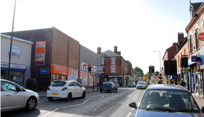 Bloxwich High Street in 2013. Bloxwich Wesleyan Church was demolished in 1963 for a TESCO store which later had other uses, and is now a furniture store.