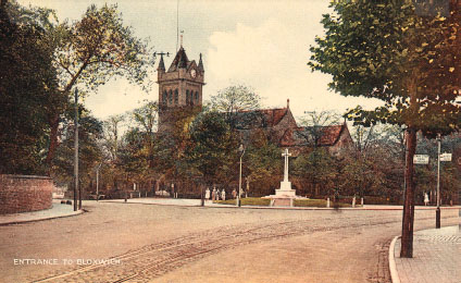 All Saints' Church, war memorial and High Street, 1920s