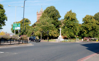 All Saints' Church, war memorial and High Street, 2013