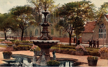 Bloxwich Fountain in Promenade Gardens, the old Music Hall and 'National' (Church of England) School are visible in the background. Late 1920s.