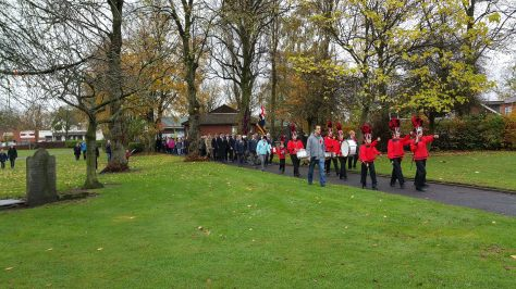 The band leads the somewhat curtailed Bloxwich Remembrance parade past the grave of Bloxwich rebel Samuel Wilks (pic Stuart Williams)