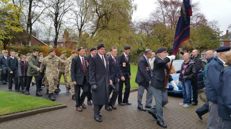 Veterans and cadets march behind the standards to enter All Saints Church (pic Stuart Williams)