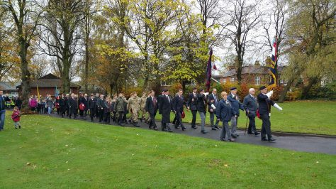 Veterans, cadets and local groups march behind the standards to All Saints Church (pic Stuart Williams)