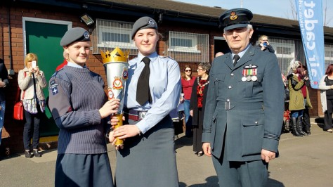 Flt Lt Ian Averill (right) of 196 (Walsall) Squadron ATC with the cadet from 240 (Darlaston) Squadron ATC (left) who handed over the75th Anniversary Torch to a cadet from 196 (Walsall) Squadron ATC, centre
