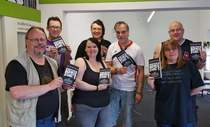 Members of 'The Southcart Storytellers' present Scott Southey and Amy Carter with the new book at the new shop premises, which are currently being refitted. L to R: A. Stuart Williams, Ken Preston, Amy Carter, Dan Oram, Scott Southey, Rachel Oram, James Josiah.