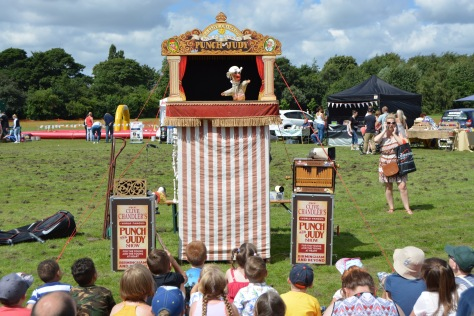 Fun in the sun with Clive Chandler's Punch and Judy attracting an appreciative crowd